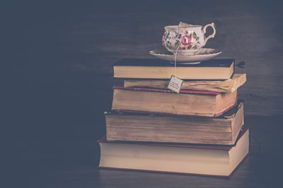 Tea cup on stack of books