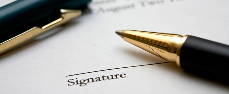 Form with pen for signing